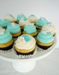 Tiffany Blue cupcakes!  The customer provided the toppers and wrappers for these little beauties.